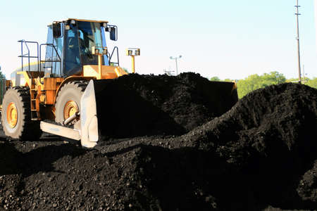 frontend: Front End Loader Moving Piles Of Coal