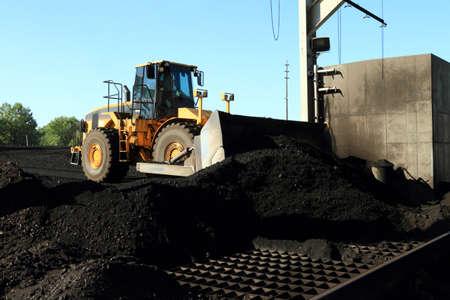 front end loader: Front End Loader Moving Piles of Coal