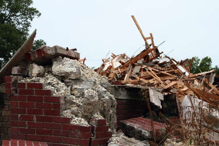 demolished: Crumbling Concrete And Falling Down Bricks With Piles Of Rubble