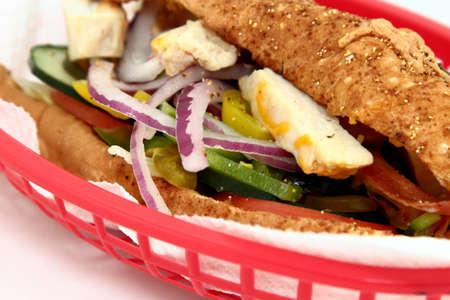 Warme kip en plantaardige SubSandwich Stockfoto