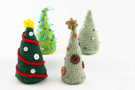 cor: Four Handcrafted Tabletop Christmas Trees Stock Photo