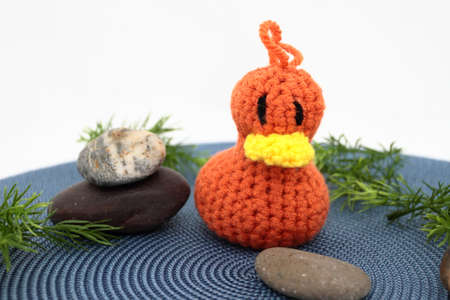 rock wool: Small Handcrafted Orange Duckling On Pretend Pond Stock Photo