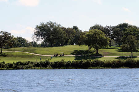 View Of Golf Course Across A Lake