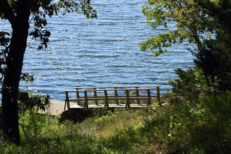 Small Bridge To Boat Dock On The Lake