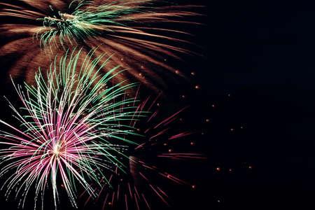 Multiple Fireworks Bursts In A Black Sky photo