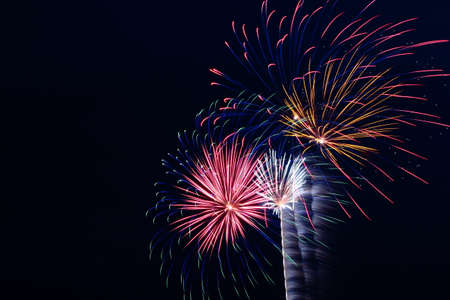 Assorted Fireworks Exploding In A Black Sky Stock Photo
