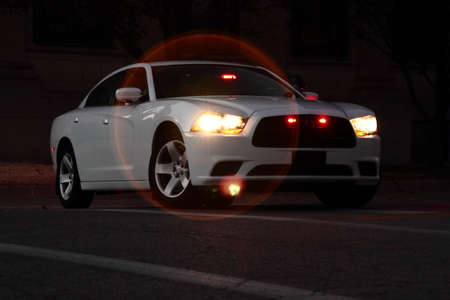 unmarked: Unmarked Police Car At Night Stock Photo
