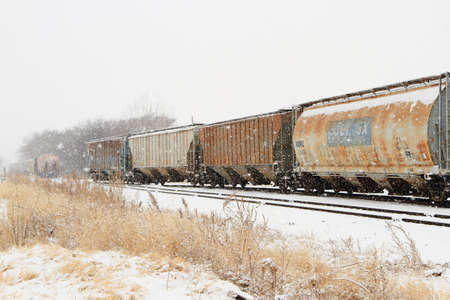 Old Train Cars On A Snowy Day