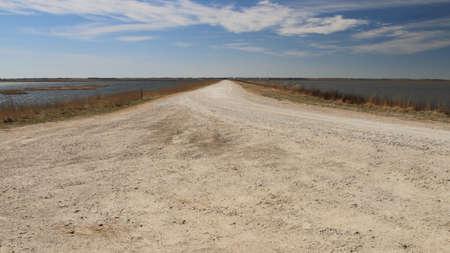 cheyenne: Dirt Road Between Two Marsh Pools
