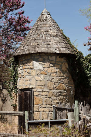 small roof: Small Round Limestone Barn With Wood Shingled Roof