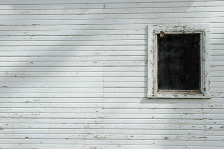 White Wall With Dark Window