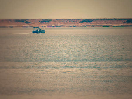 Aged Image Of One Boat On A Lake