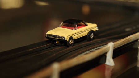 Vintage Toy Car On Racing Track Stock Photo