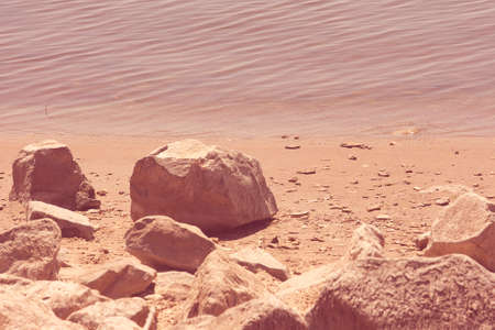 Rocks On The Shoreline At The Lake
