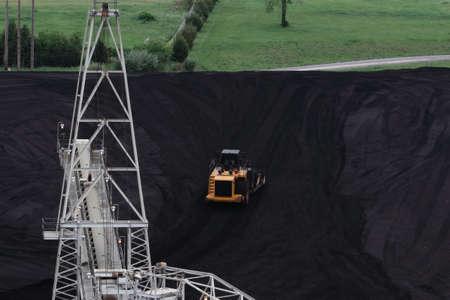 Bulldozer Moving Coal Away From Conveyer Belt Stock Photo