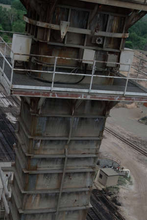 Towering Steel Structure Near Railway Tracks Stock Photo