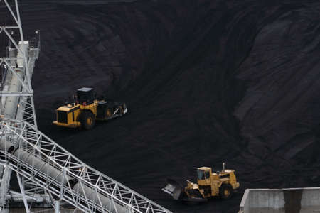 Two Bulldozer Moving Coal