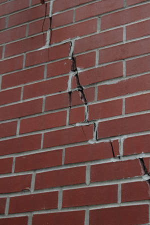 Red Brick Wall With Large Crack