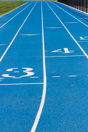 Close Up Of Blue School Track Stock Photo