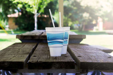 Disposable Cups On Picnic Table