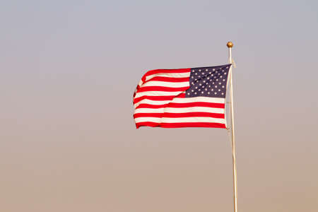 American Flag On Windy Evening Stock Photo
