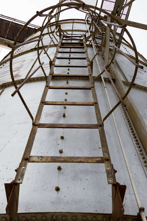Looking Up The Ladder Of A Grain Bin Stock Photo