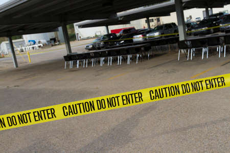 Caution Tape Across Parking Lot