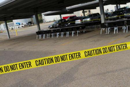 Caution Tape Across Parking Lot