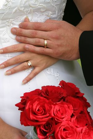 bride and groom and wedding rings photo