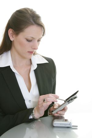 woman entering information into palm pilot photo