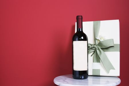 gift  with bottle of red wine Stock Photo