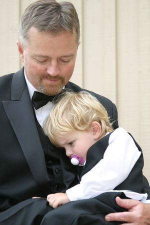 descendants: grandfather and grandson all dressed up Stock Photo
