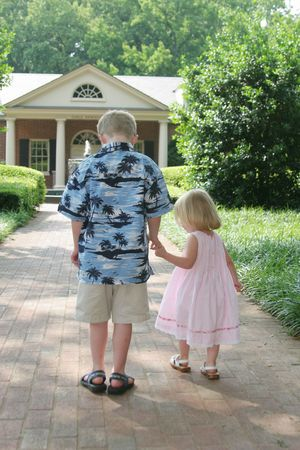 in loving memory: bother and sister walking and holding hands Stock Photo