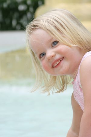happy little girl  beside fountain Stock Photo