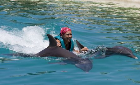 girl swimming: Swimming with the Dolphins