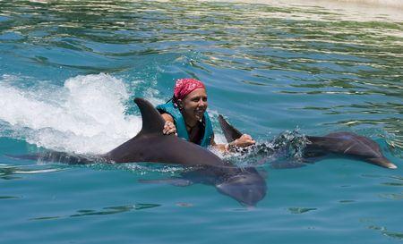 meisje zwemmen: Zwemmen met de dolfijnen