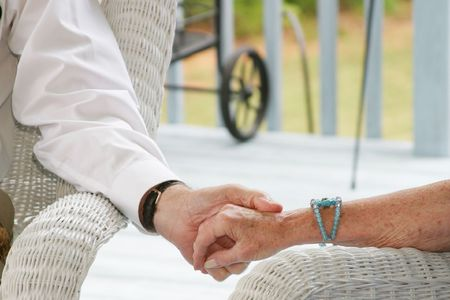 Seniors holding hands photo