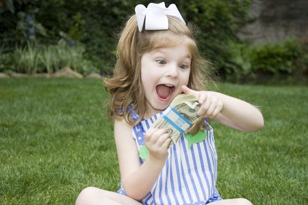 monies: Expressive girl with a bunch of money Stock Photo