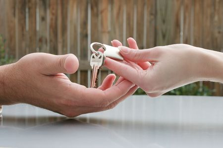 Man handing a woman a set of keys photo