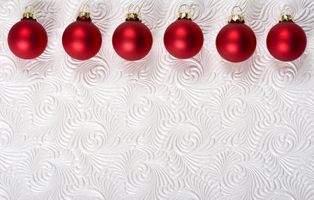 Red ornaments along top and on white swirl background photo