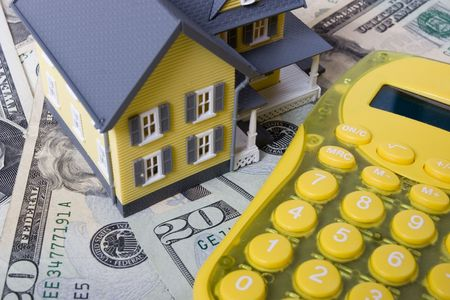 downpayment: House with twenty dollar bills background and calculator