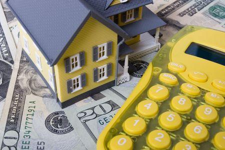 House with twenty dollar bills background and calculator Stock Photo - 576194
