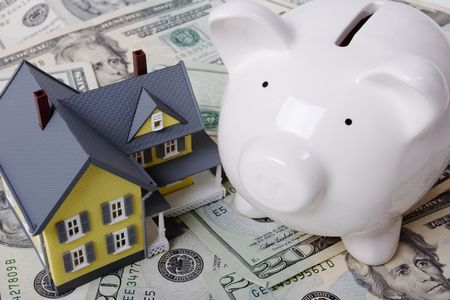 in escrow: House with twenty dollar bills background and piggy bank