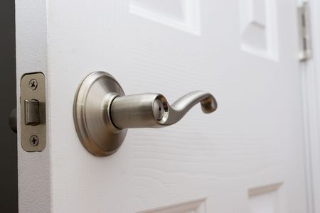 Lever Door Handle With Child Safety Lock Stock Photo, Picture And Royalty  Free Image. Image 576171.