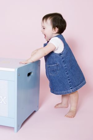 exuberance: Cute baby standing and smiling with copy  space