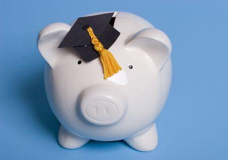 Piggy bank with a graduation cap photo