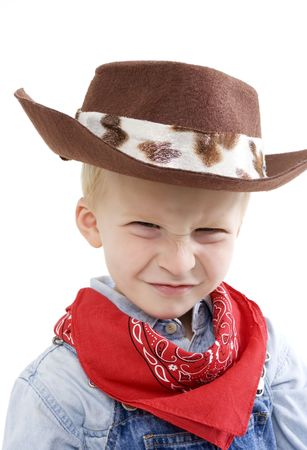 cowboy up: Happy young boy with a cowboy hat making a cute face