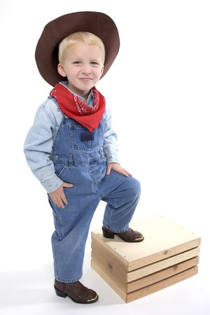 up country: Happy young boy with a cowboy hat  and cowboy boots
