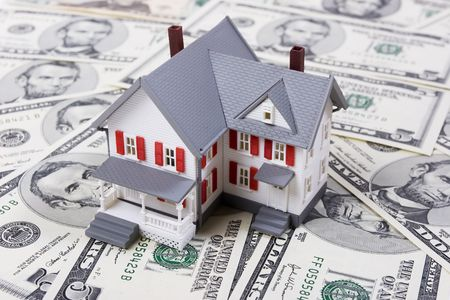 Two-story house with five dollar bills background Stock Photo