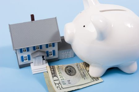 downpayment: Two-story house with twenty dollar bill and a piggy bank